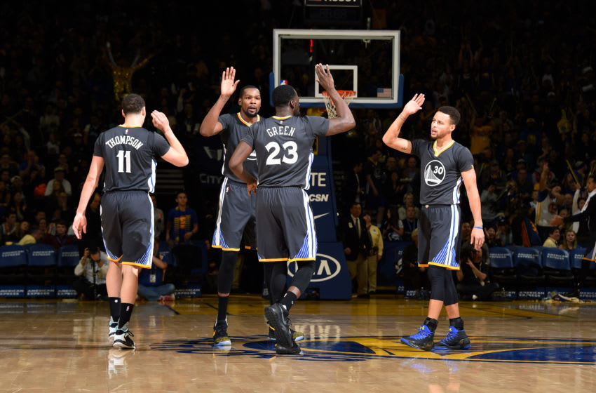 OAKLAND, CA - DECEMBER 17: Draymond Green #23, Stephen Curry #30, Kevin Durant #35 and Klay Thompson #11 of the Golden State Warriors high five each other during the game against the Portland Trail Blazers on December 17, 2016 in Oakland, California. NOTE TO USER: User expressly acknowledges and agrees that, by downloading and/or using this Photograph, user is consenting to the terms and conditions of the Getty Images License Agreement. Mandatory Copyright Notice: Copyright 2016 NBAE (Photo by Andrew D. Bernstein/NBAE via Getty Images)