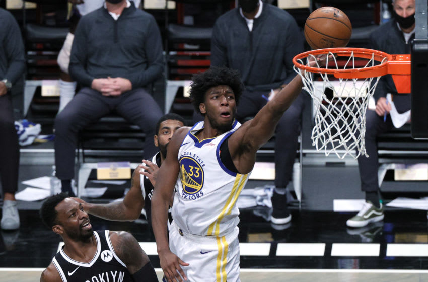NEW YORK, NEW YORK - DECEMBER 22: James Wiseman #33 of the Golden State Warriors attempts a layup against Jeff Green #8 and Kyrie Irving #11 of the Brooklyn Nets during the first half at Barclays Center on December 22, 2020 in the Brooklyn borough of New York City. NOTE TO USER: User expressly acknowledges and agrees that, by downloading and/or using this photograph, user is consenting to the terms and conditions of the Getty Images License Agreement. (Photo by Sarah Stier/Getty Images)