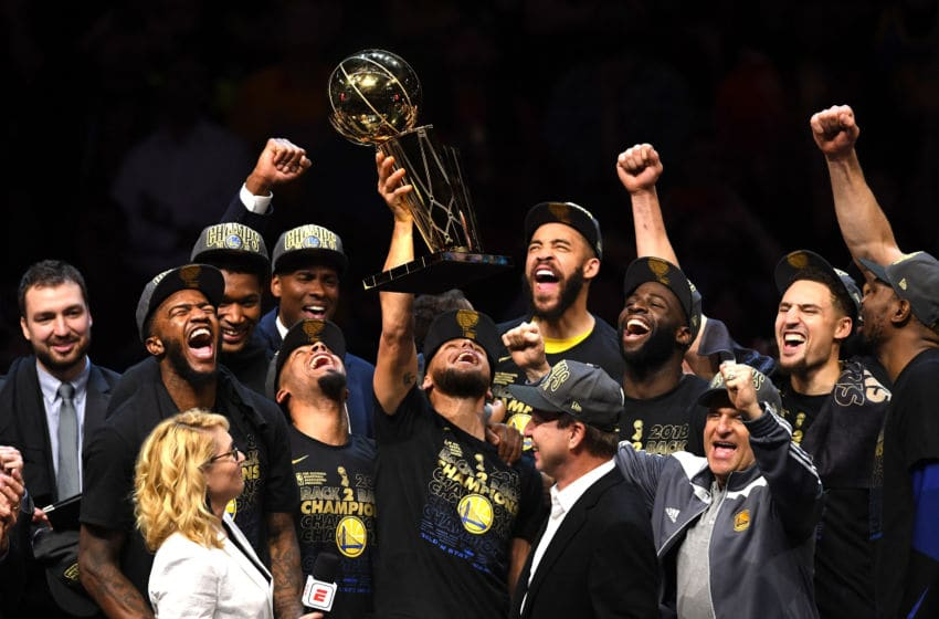 CLEVELAND, OH - JUNE 08: Stephen Curry #30 of the Golden State Warriors celebrates with the Larry O'Brien Trophy after defeating the Cleveland Cavaliers during Game Four of the 2018 NBA Finals at Quicken Loans Arena on June 8, 2018 in Cleveland, Ohio. The Warriors defeated the Cavaliers 108-85 to win the 2018 NBA Finals. NOTE TO USER: User expressly acknowledges and agrees that, by downloading and or using this photograph, User is consenting to the terms and conditions of the Getty Images License Agreement. (Photo by Jason Miller/Getty Images)