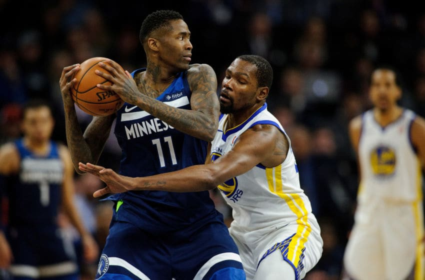 MINNEAPOLIS, MN - MARCH 11: Jamal Crawford #11 of the Minnesota Timberwolves has the ball against Kevin Durant #35 of the Golden State Warriors during the game on March 11, 2018 at the Target Center in Minneapolis, Minnesota. NOTE TO USER: User expressly acknowledges and agrees that, by downloading and or using this Photograph, user is consenting to the terms and conditions of the Getty Images License Agreement. (Photo by Hannah Foslien/Getty Images)