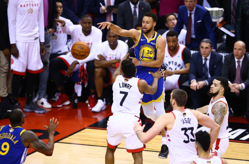 TORONTO, ONTARIO - JUNE 10: Stephen Curry #30 of the Golden State Warriors attempts a pass against the Toronto Raptors in the second half during Game Five of the 2019 NBA Finals at Scotiabank Arena on June 10, 2019 in Toronto, Canada. NOTE TO USER: User expressly acknowledges and agrees that, by downloading and or using this photograph, User is consenting to the terms and conditions of the Getty Images License Agreement. (Photo by Vaughn Ridley/Getty Images)