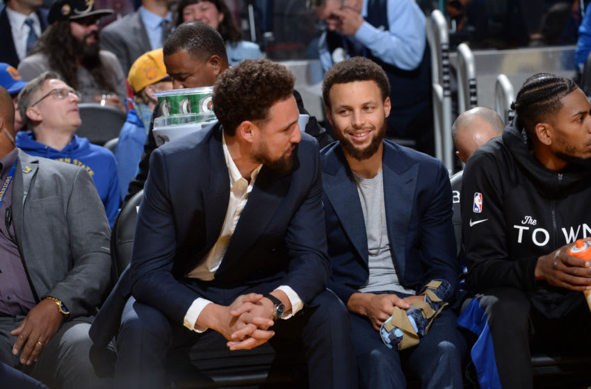 SAN FRANCISCO, CA - NOVEMBER 27: Klay Thompson #11 of the Golden State Warriors and Stephen Curry #30 of the Golden State Warriors smile during a game against the Chicago Bulls on November 27, 2019 at Chase Center in San Francisco, California. NOTE TO USER: User expressly acknowledges and agrees that, by downloading and or using this photograph, user is consenting to the terms and conditions of Getty Images License Agreement. Mandatory Copyright Notice: Copyright 2019 NBAE (Photo by Noah Graham/NBAE via Getty Images)