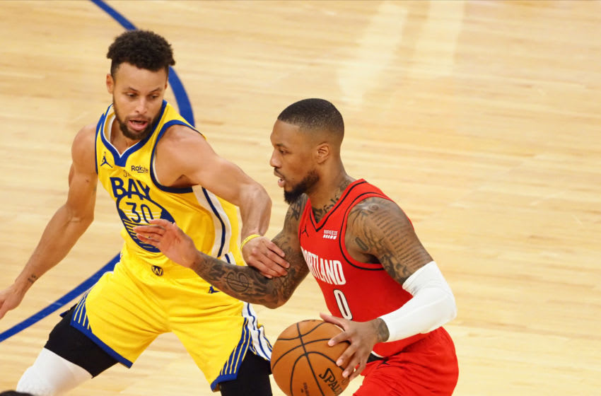 Jan 3, 2021; San Francisco, California, USA; Portland Trail Blazers guard Damian Lillard (0) controls the ball against Golden State Warriors guard Stephen Curry (30) during the third quarter at Chase Center. Mandatory Credit: Kelley L Cox-USA TODAY Sports