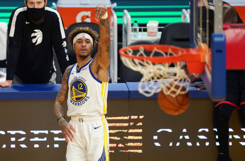 Jan 10, 2021; San Francisco, California, USA; Golden State Warriors guard Kelly Oubre Jr. (12) hits a 3-pointer during the fourth quarter against the Toronto Raptors at Chase Center. Mandatory Credit: Darren Yamashita-USA TODAY Sports