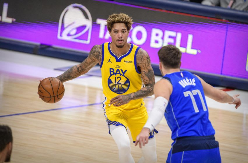 Feb 4, 2021; Dallas, Texas, USA; Dallas Mavericks guard Luka Doncic (77) guards Golden State Warriors guard Kelly Oubre Jr. (12) during the second half at the American Airlines Center. Mandatory Credit: Jerome Miron-USA TODAY Sports