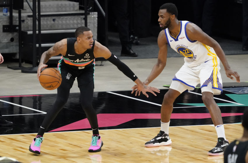 Feb 9, 2021; San Antonio, Texas, USA; San Antonio Spurs guard Dejounte Murray (5) dribbles the ball while defended by Golden State Warriors forward Andrew Wiggins (22) defends in the third quarter at AT&T Center. Mandatory Credit: Scott Wachter-USA TODAY Sports