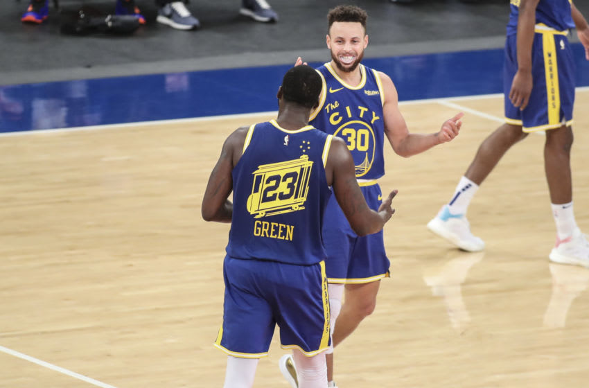 Feb 23, 2021; New York, New York, USA; Golden State Warriors guard Stephen Curry (30) and forward Draymond Green (23) celebrate the 114-106 victory over the New York Knicks at Madison Square Garden. Mandatory Credit: Wendell Cruz-USA TODAY Sports