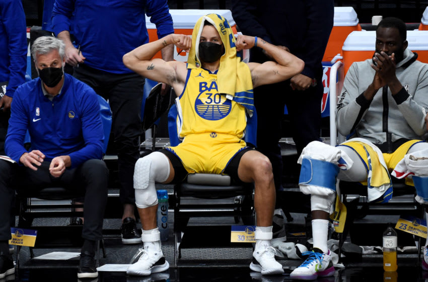 Mar 3, 2021; Portland, Oregon, USA; Golden State Warriors guard Stephen Curry (30) reacts from the bench to a teammates basket during the first half of the game against the Portland Trail Blazers at Moda Center. Mandatory Credit: Steve Dykes-USA TODAY SPORTS