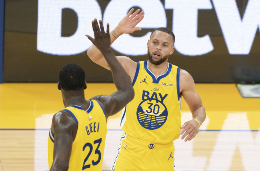 April 25, 2021; San Francisco, California, USA; Golden State Warriors guard Stephen Curry (30) celebrates with forward Draymond Green (23) against the Sacramento Kings during the third quarter at Chase Center. Mandatory Credit: Kyle Terada-USA TODAY Sports
