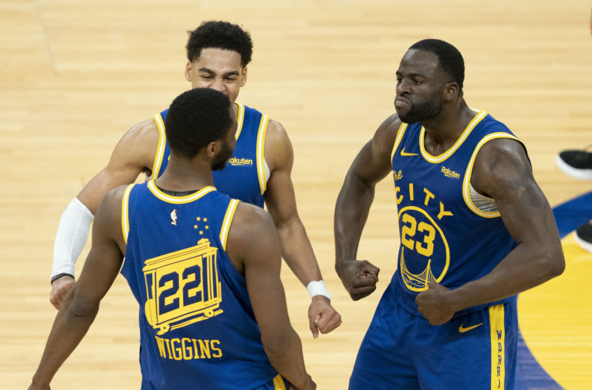 May 11, 2021; San Francisco, California, USA; Golden State Warriors forward Draymond Green (23) celebrates with forward Andrew Wiggins (22) against the Phoenix Suns during the fourth quarter at Chase Center. Mandatory Credit: Kyle Terada-USA TODAY Sports