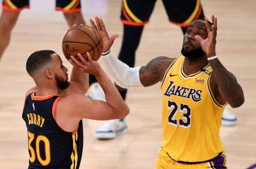 May 19, 2021; Los Angeles, California, USA; Golden State Warriors guard Stephen Curry (30) shoots a basket over Los Angeles Lakers forward LeBron James (23) in the first half of the game at Staples Center. Mandatory Credit: Jayne Kamin-Oncea-USA TODAY Sports