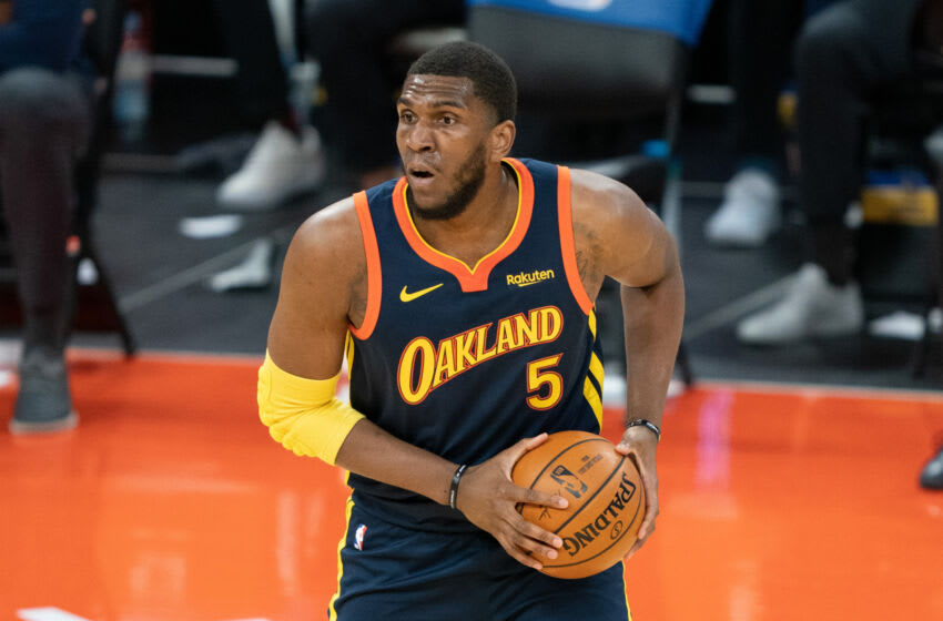 March 23, 2021; San Francisco, California, USA; Golden State Warriors center Kevon Looney (5) during the second quarter against the Philadelphia 76ers at Chase Center. Mandatory Credit: Kyle Terada-USA TODAY Sports