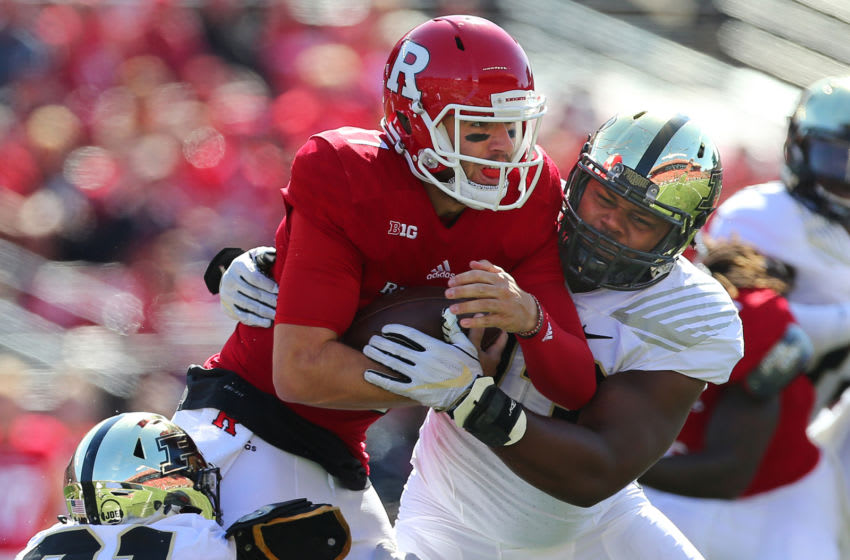 PISCATAWAY, NJ - OCTOBER 21: Quarterback Giovanni Rescigno #17 of the Rutgers Scarlet Knights is sacked by Gelen Robinson #13 and Markus Bailey #21 of Purdue Boilermakers during the first quarter of a game at Rutgers on October 21, 2017 in Piscataway, New Jersey. (Photo by Rich Schultz/Getty Images)