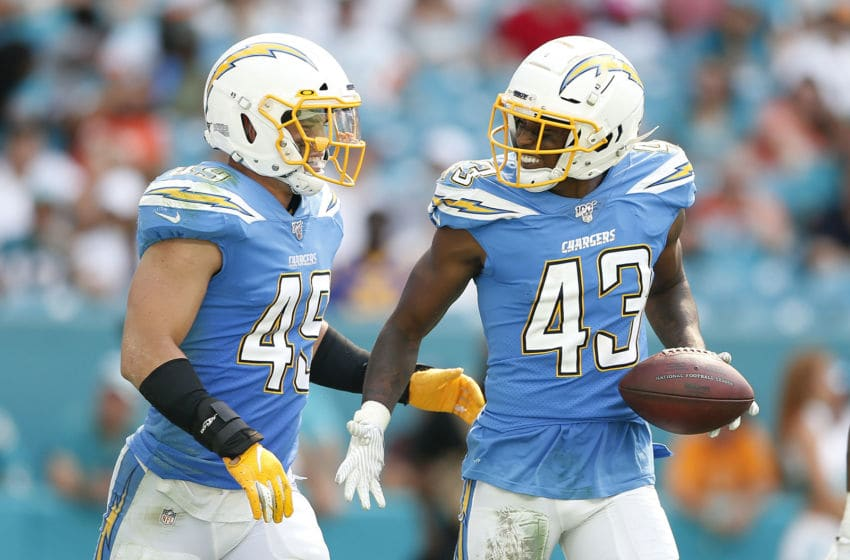 MIAMI, FLORIDA - SEPTEMBER 29: Michael Davis #43 of the Los Angeles Chargers celebrates with Drue Tranquill #49 after a interception against the Miami Dolphins during the fourth quarter at Hard Rock Stadium on September 29, 2019 in Miami, Florida. (Photo by Michael Reaves/Getty Images)