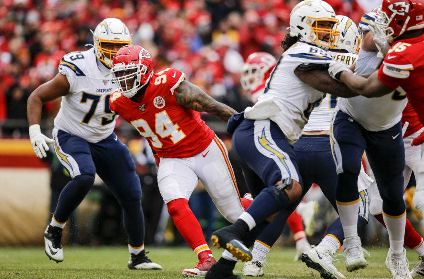 KANSAS CITY, MO - DECEMBER 29: Terrell Suggs #94 of the Kansas City Chiefs breaks past Trey Pipkins #79 of the Los Angeles Chargers during the third quarter at Arrowhead Stadium on December 29, 2019 in Kansas City, Missouri. (Photo by David Eulitt/Getty Images)