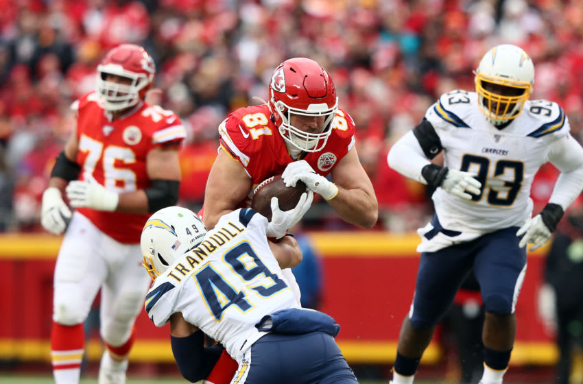 KANSAS CITY, MISSOURI - DECEMBER 29: Tight end Blake Bell #81 of the Kansas City Chiefs is tackled by linebacker Drue Tranquill #49 of the Los Angeles Chargers after making a catch during the game at Arrowhead Stadium on December 29, 2019 in Kansas City, Missouri. (Photo by Jamie Squire/Getty Images)