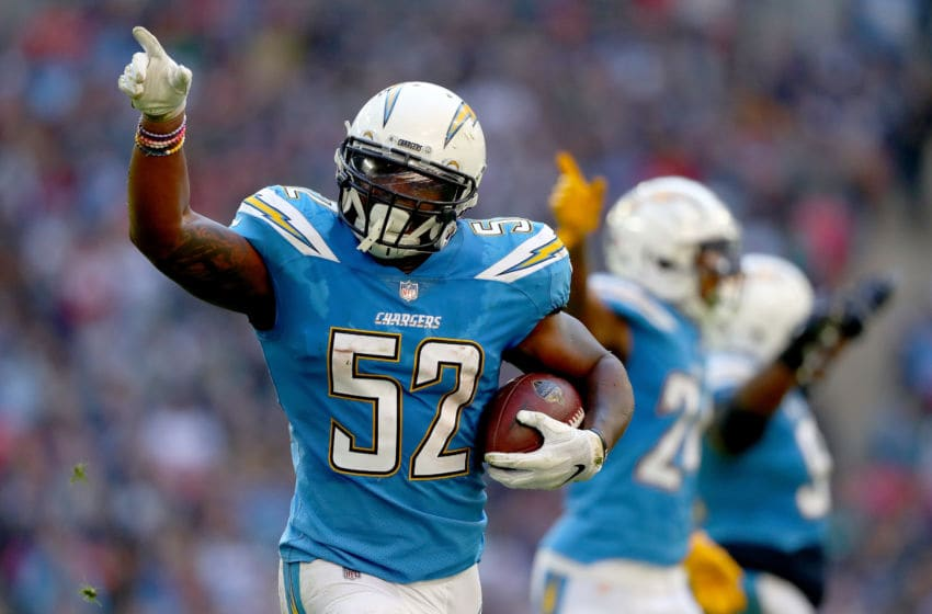 LONDON, ENGLAND - OCTOBER 21: Denzel Perryman of Los Angeles Chargers celebrates his interception during the NFL International Series match between Tennessee Titans and Los Angeles Chargers at Wembley Stadium on October 21, 2018 in London, England. (Photo by Clive Rose/Getty Images)