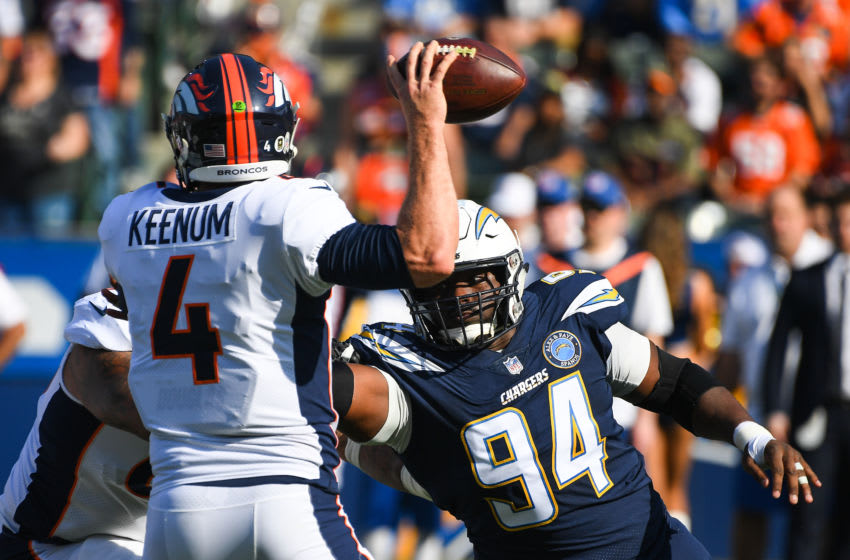 CARSON, CA - NOVEMBER 18: Defensive tackle Corey Liuget #94 of the Los Angeles Chargers pressures quarterback Case Keenum #4 of the Denver Broncos as he tries to pass in the first quarter at StubHub Center on November 18, 2018 in Carson, California. (Photo by Jayne Kamin-Oncea/Getty Images)