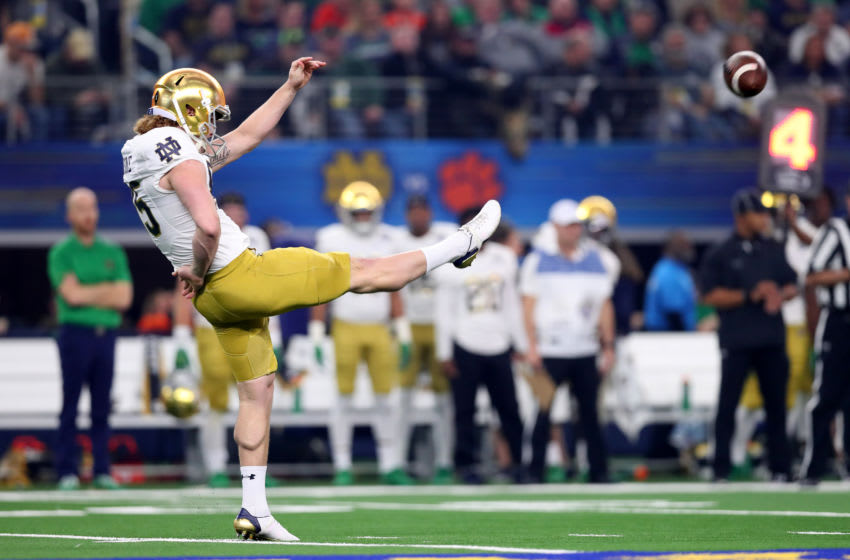 ARLINGTON, TEXAS - DECEMBER 29: Tyler Newsome #85 of the Notre Dame Fighting Irish punts in the first quarter against the Clemson Tigers during the College Football Playoff Semifinal Goodyear Cotton Bowl Classic at AT&T Stadium on December 29, 2018 in Arlington, Texas. (Photo by Tom Pennington/Getty Images)