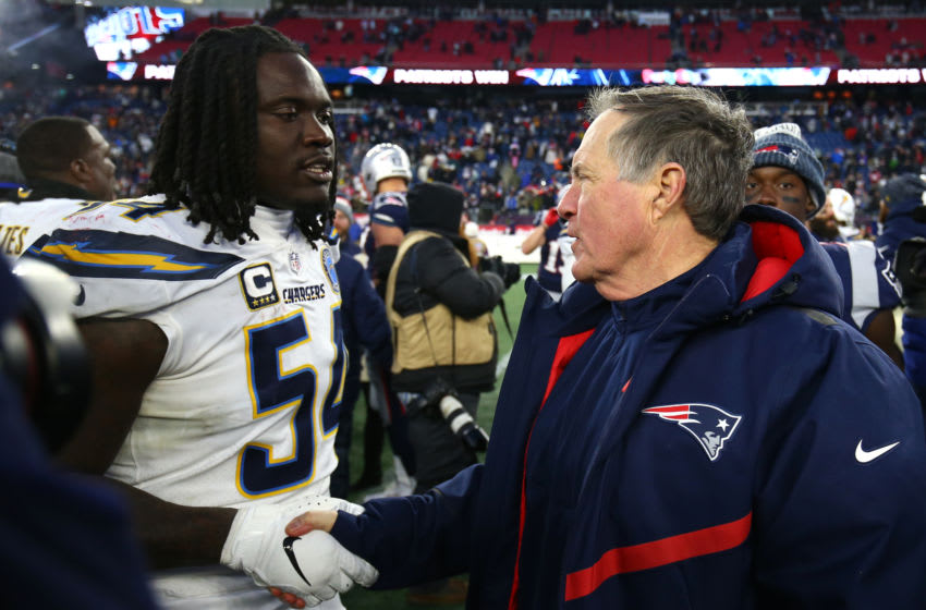 FOXBOROUGH, MASSACHUSETTS - JANUARY 13: Head coach Bill Belichick of the New England Patriots shakes hands with Melvin Ingram #54 of the Los Angeles Chargers after the AFC Divisional Playoff Game at Gillette Stadium on January 13, 2019 in Foxborough, Massachusetts. (Photo by Adam Glanzman/Getty Images)