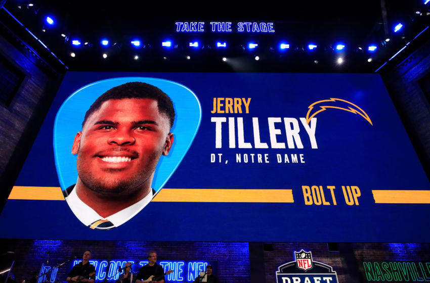 NASHVILLE, TENNESSEE - APRIL 25: A video board displays an image of Jerry Tillery of Notre Dame after he was chosen #28 overall by the Los Angeles Chargers during the first round of the 2019 NFL Draft on April 25, 2019 in Nashville, Tennessee. (Photo by Andy Lyons/Getty Images)