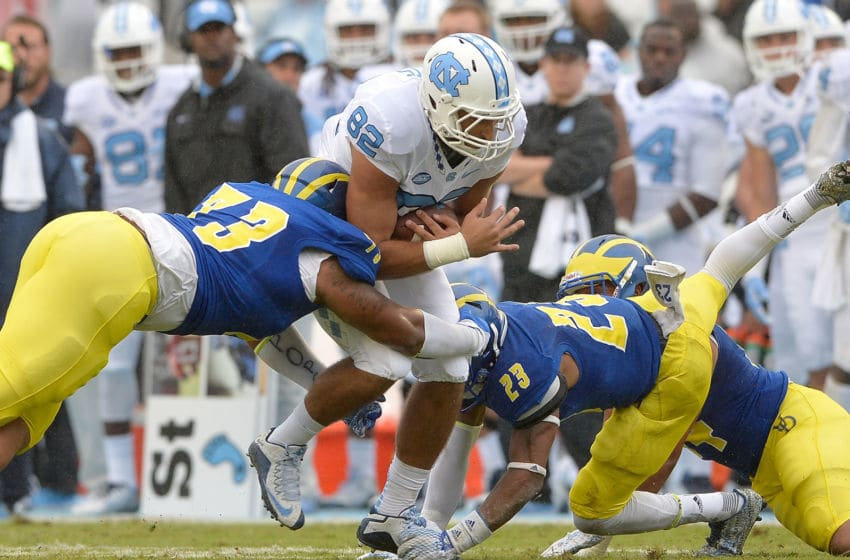 CHAPEL HILL, NC - SEPTEMBER 26: Blaine Woodson #73 and Nasir Adderley #23 of the Delaware Fightin Blue Hens tackle Brandon Fritts #82 of the North Carolina Tar Heels during their game at Kenan Stadium on September 26, 2015 in Chapel Hill, North Carolina. (Photo by Grant Halverson/Getty Images)