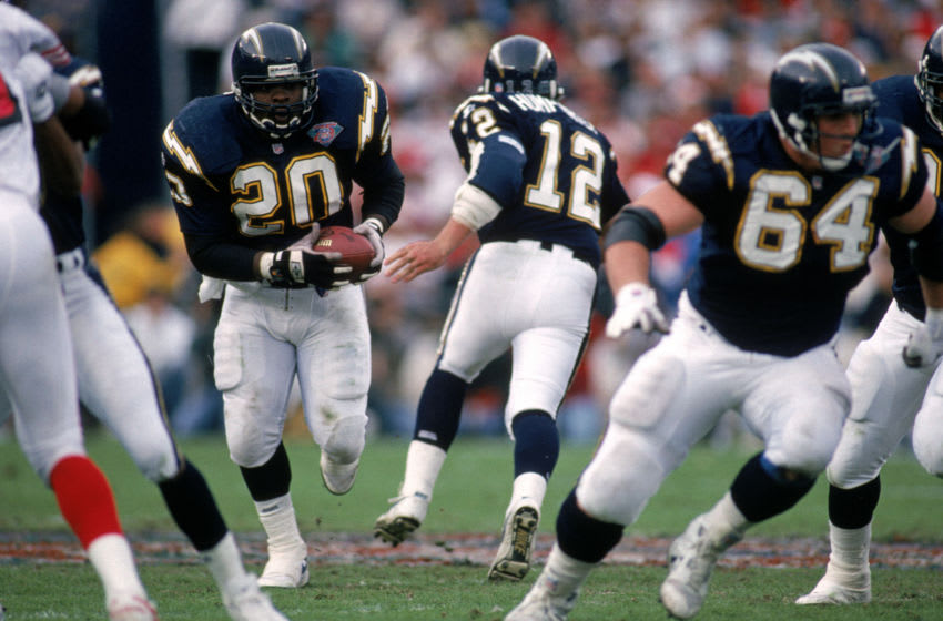 SAN DIEGO - DECEMBER 11: Running back Natrone Means #20 of the San Diego Chargers finds room to run against the San Francisco 49ers defense during a game at Jack Murphy Stadium on December 11, 1994 in San Diego, California. The 49ers won 38-15. (Photo by George Rose/Getty Images)