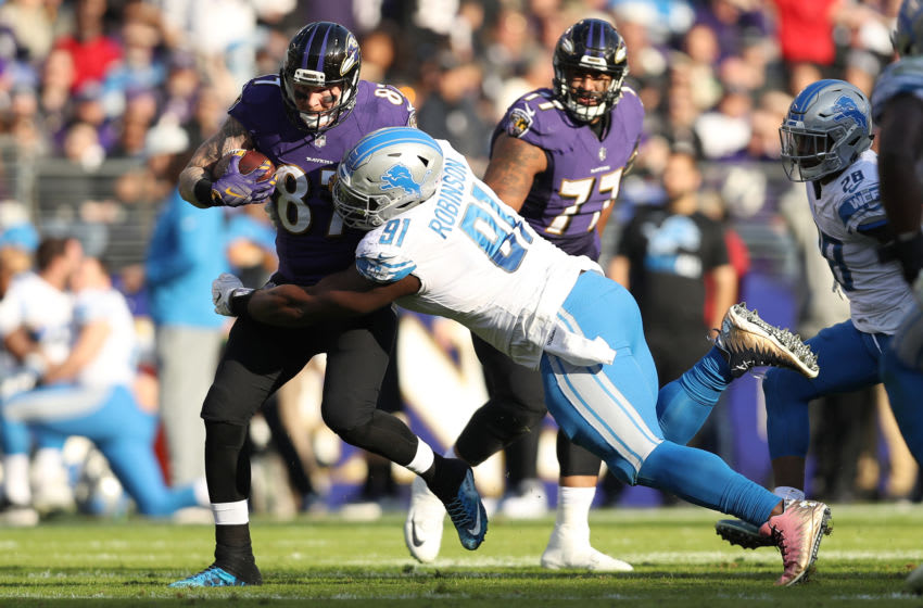 BALTIMORE, MD - DECEMBER 3: Tight End Maxx Williams #87 of the Baltimore Ravens runs with the ball as he is tackled by defensive tackle A'Shawn Robinson #91 of the Detroit Lions at M&T Bank Stadium on December 3, 2017 in Baltimore, Maryland. (Photo by Patrick Smith/Getty Images)
