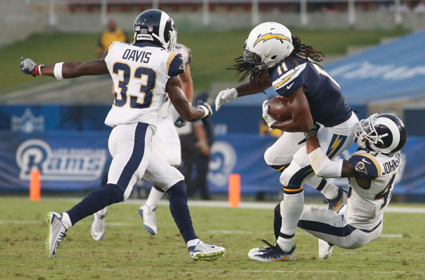 LOS ANGELES, CA - AUGUST 26: John Johnson III #43 of the Los Angeles Rams tackles Geremy Davis #11 of the Los Angeles Chargers during the preseason game between the Los Angeles Rams and Los Angeles Chargers at the Los Angeles Memorial Coliseum on August 26, 2017 in Los Angeles, California. (Photo by Josh Lefkowitz/Getty Images)