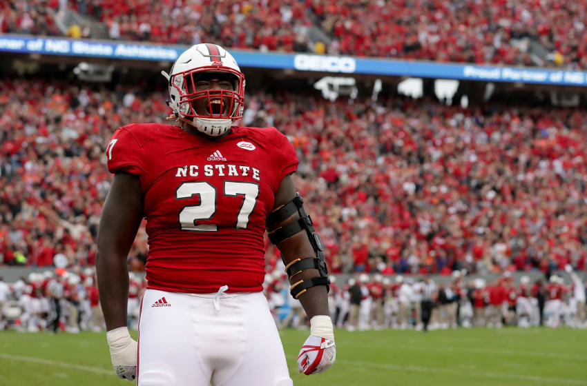 RALEIGH, NC - NOVEMBER 04: Justin Jones #27 of the North Carolina State Wolfpack reacts after a play against the Clemson Tigers walks during their game at Carter Finley Stadium on November 4, 2017 in Raleigh, North Carolina. (Photo by Streeter Lecka/Getty Images)