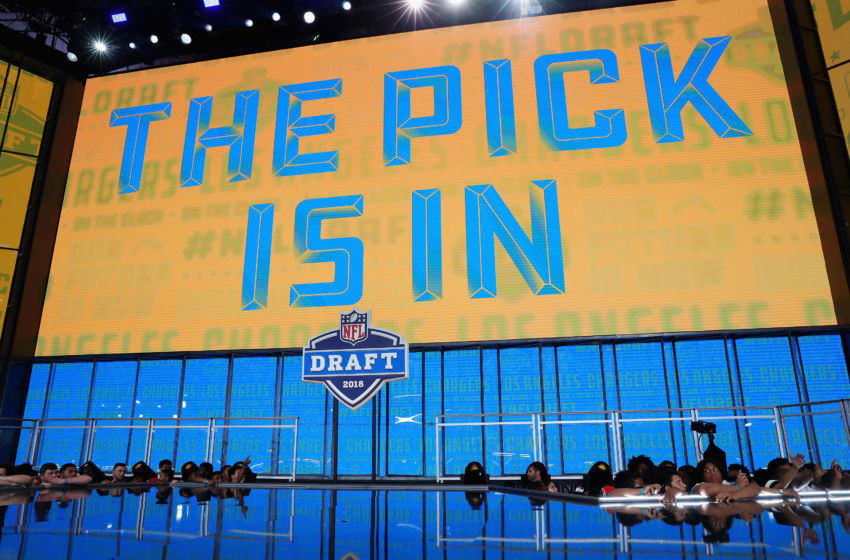 ARLINGTON, TX - APRIL 26: A video board displays the text 'THE PICK IS IN' for the Los Angeles Chargers during the first round of the 2018 NFL Draft at AT