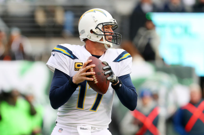 EAST RUTHERFORD, NJ - DECEMBER 24: Philip Rivers #17 of the Los Angeles Chargers looks to pass during the first half against the New York Jets in an NFL game at MetLife Stadium on December 24, 2017 in East Rutherford, New Jersey. (Photo by Ed Mulholland/Getty Images)
