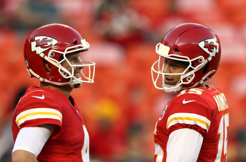 KANSAS CITY, MO - AUGUST 30: Quarterback Patrick Mahomes #15 of the Kansas City Chiefs talks with quarterback Chad Henne #4 during warm-ups prior to the preseason game against the Green Bay Packers at Arrowhead Stadium on August 30, 2018 in Kansas City, Missouri. (Photo by Jamie Squire/Getty Images)