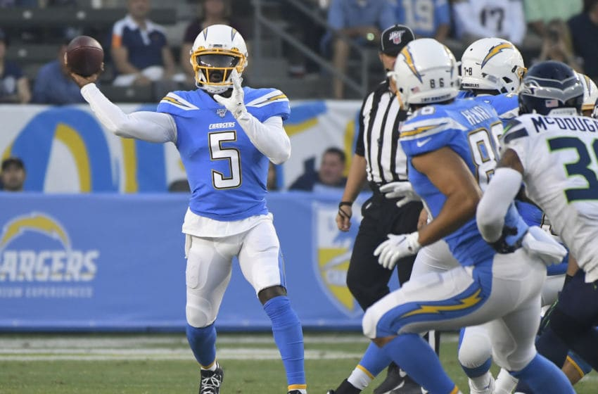 CARSON, CA - AUGUST 24: Tyrod Taylor #5 of the Los Angeles Chargers throws a short pass against the Seattle Seahawks in the first quaarter during a pre-season NFL football game at Dignity Health Sports Park on August 24, 2019 in Carson, California. (Photo by John McCoy/Getty Images)