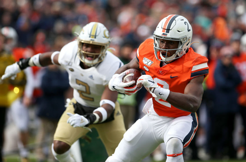 CHARLOTTESVILLE, VA - NOVEMBER 09: Joe Reed #2 of the Virginia Cavaliers scores a touchdown past Tariq Carpenter #2 of the Georgia Tech Yellow Jackets in the first half during a game at Scott Stadium on November 9, 2019 in Charlottesville, Virginia. (Photo by Ryan M. Kelly/Getty Images)
