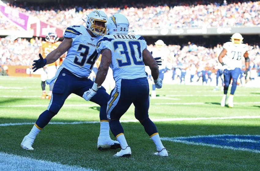 CHICAGO, ILLINOIS - OCTOBER 27: Austin Ekeler #30 of the Los Angeles Chargers celebrates with Derek Watt #34 after scoring a touchdown during the second half of a game against the Chicago Bears at Soldier Field on October 27, 2019 in Chicago, Illinois. (Photo by Stacy Revere/Getty Images)