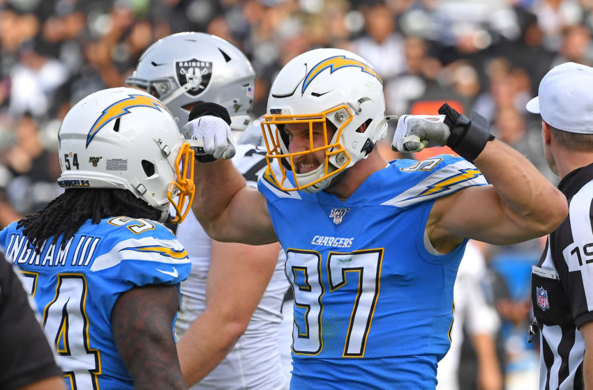 CARSON, CA - DECEMBER 22: Defensive end Joey Bosa #97 flexes for defensive end Melvin Ingram #54 of the Los Angeles Chargers after a sack of quarterback Derek Carr #4 of the Oakland Raiderss in the first half of the game at Dignity Health Sports Park on December 22, 2019 in Carson, California. (Photo by Jayne Kamin-Oncea/Getty Images)