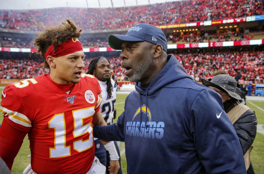 KANSAS CITY, MO - DECEMBER 29: Head coach Anthony Lynn of the Los Angeles Chargers speaks with Patrick Mahomes #15 of the Kansas City Chiefs following the 31-21 victory by the Kansas City Chiefs at Arrowhead Stadium on December 29, 2019 in Kansas City, Missouri. (Photo by David Eulitt/Getty Images)