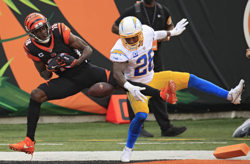 CINCINNATI, OHIO - SEPTEMBER 13: Wide receiver Trenton Irwin #16 of the Cincinnati Bengals cannot make a catch in front of cornerback Casey Hayward #26 of the Los Angeles Chargers during the second half at Paul Brown Stadium on September 13, 2020 in Cincinnati, Ohio. (Photo by Andy Lyons/Getty Images)
