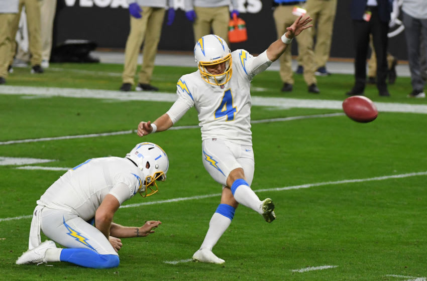 LAS VEGAS, NEVADA - DECEMBER 17: Punter Ty Long #1 of the Los Angeles Chargers holds as kicker Mike Badgley #4 kicks a 22-yard field goal against the Las Vegas Raiders during the first half of their game at Allegiant Stadium on December 17, 2020 in Las Vegas, Nevada. (Photo by Ethan Miller/Getty Images)