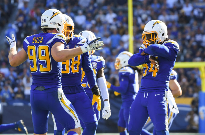 CARSON, CA - NOVEMBER 25: Defensive end Joey Bosa #99 of the Los Angeles Chargers celebrates his sack with defensive end Melvin Ingram #54 in the second quarter against the Arizona Cardinals at StubHub Center on November 25, 2018 in Carson, California. (Photo by Harry How/Getty Images)