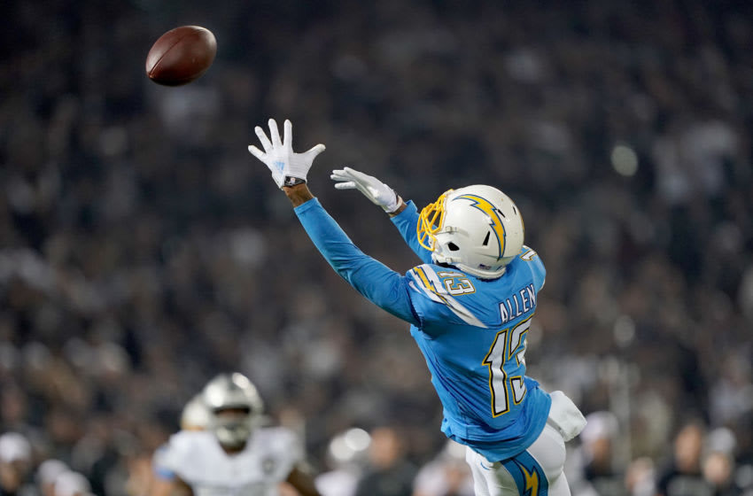 OAKLAND, CALIFORNIA - NOVEMBER 07: Keenan Allen #13 of the Los Angeles Chargers dives but watches the ball go over his head just of his reach against the Oakland Raiders during the first quarter of an NFL football game at RingCentral Coliseum on November 07, 2019 in Oakland, California. The ball was intercepted by Erik Harris #25. (Photo by Thearon W. Henderson/Getty Images)