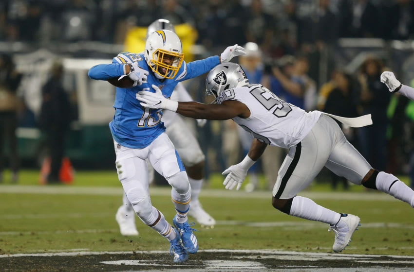 OAKLAND, CALIFORNIA - NOVEMBER 07: Keenan Allen #13 of the Los Angeles Chargers evades a tackle by Nicholas Morrow #50 of the Oakland Raiders in the second quarter at RingCentral Coliseum on November 07, 2019 in Oakland, California. (Photo by Lachlan Cunningham/Getty Images)
