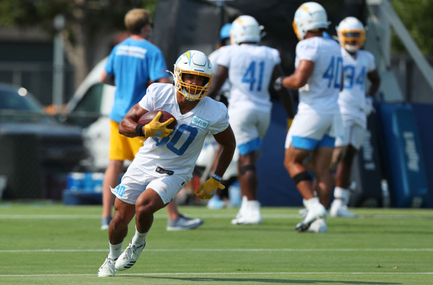 COSTA MESA, CALIFORNIA - AUGUST 19: Austin Ekeler #30 of the Los Angeles Chargers runs with the ball in front of his team during Los Angeles Chargers Training Camp on August 19, 2020 in Costa Mesa, California. (Photo by Joe Scarnici/Getty Images)