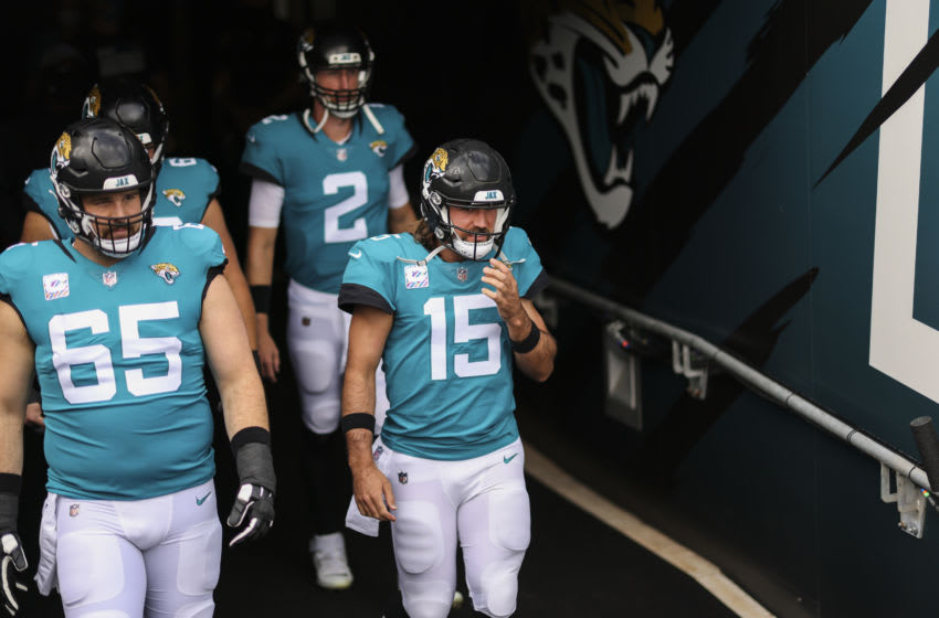 JACKSONVILLE, FLORIDA - OCTOBER 18: Gardner Minshew #15 of the Jacksonville Jaguars and teammates Mike Glennon #2 and Brandon Linder #65 enter the field before the start of a game against the Detroit Lions at TIAA Bank Field on October 18, 2020 in Jacksonville, Florida. (Photo by James Gilbert/Getty Images)