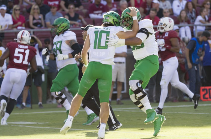 PALO ALTO, CA - SEPTEMBER 21: Justin Herbert #10 and Penei Sewell #58 of the Oregon Ducks celebrate a touchdown pass during an NCAA Pac-12 college football game against the Stanford Cardinal on September 21, 2019 at Stanford Stadium in Palo Alto, California. (Photo by David Madison/Getty Images)