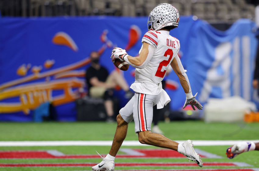 NEW ORLEANS, LOUISIANA - JANUARY 01: Chris Olave #2 of the Ohio State Buckeyes scores a touchdown against Derion Kendrick #1 of the Clemson Tigers in the third quarter during the College Football Playoff semifinal game at the Allstate Sugar Bowl at Mercedes-Benz Superdome on January 01, 2021 in New Orleans, Louisiana. (Photo by Kevin C. Cox/Getty Images)