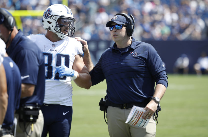 NASHVILLE, TN - AUGUST 19: Tight ends coach Arthur Smith of the Tennessee Titans talks with Phillip Supernaw #89 during a preseason game against the Carolina Panthers at Nissan Stadium on August 19, 2017 in Nashville, Tennessee. (Photo by Joe Robbins/Getty Images)