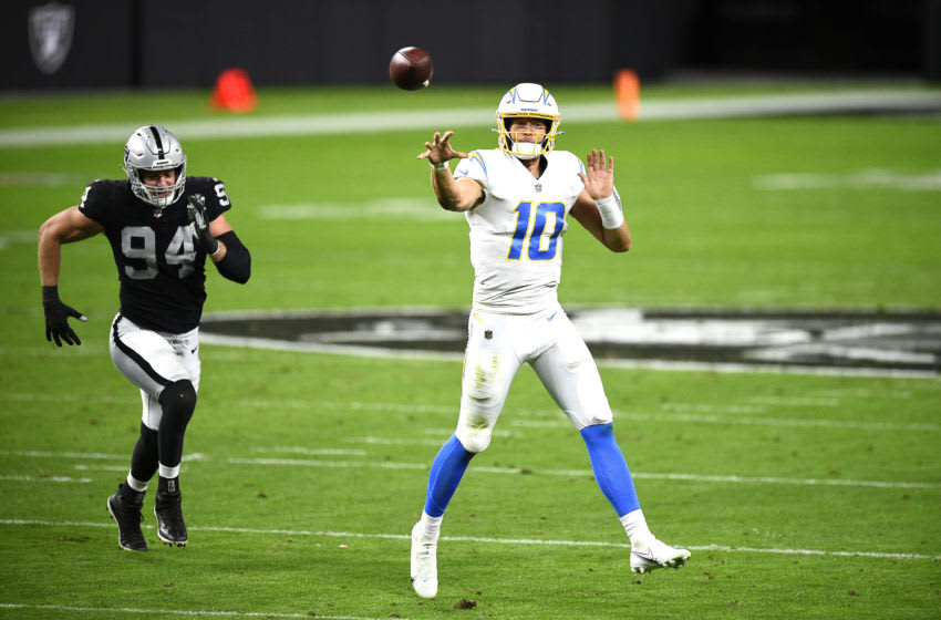 LAS VEGAS, NEVADA - DECEMBER 17: Justin Herbert #10 of the Los Angeles Chargers throws a pass during the first half against the Las Vegas Raiders at Allegiant Stadium on December 17, 2020 in Las Vegas, Nevada. (Photo by Chris Unger/Getty Images)