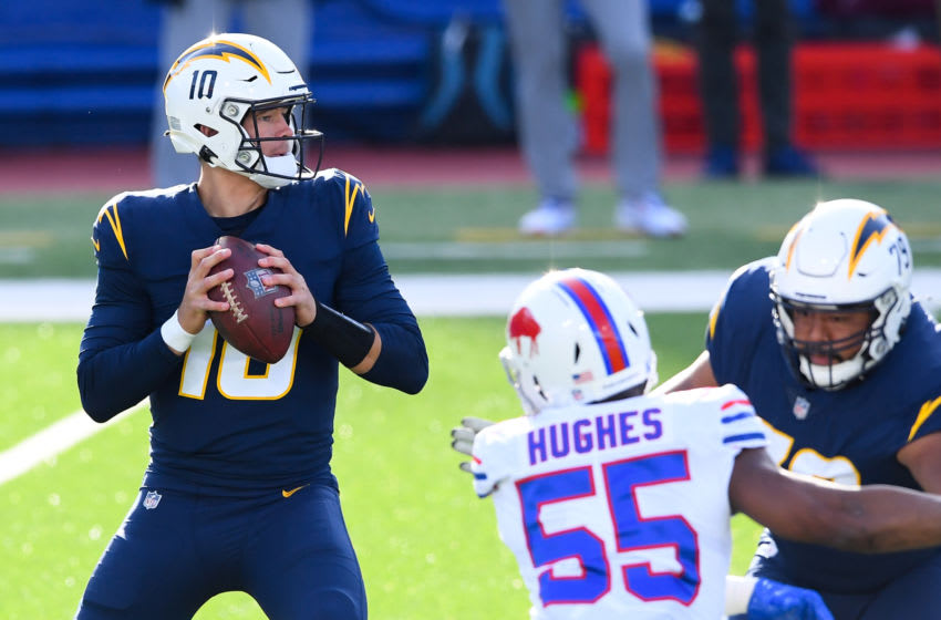 Nov 29, 2020; Orchard Park, New York, USA; Los Angeles Chargers quarterback Justin Herbert (10) drops back to pass against the Buffalo Bills during the first quarter at Bills Stadium. Mandatory Credit: Rich Barnes-USA TODAY Sports